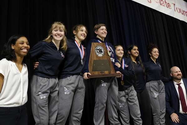 The girls Katy Tompkins team with the second place trophy at the state high school wrestling championships Saturday, Feb. 22, 2020 at the Berry Center in Cypress, TX.