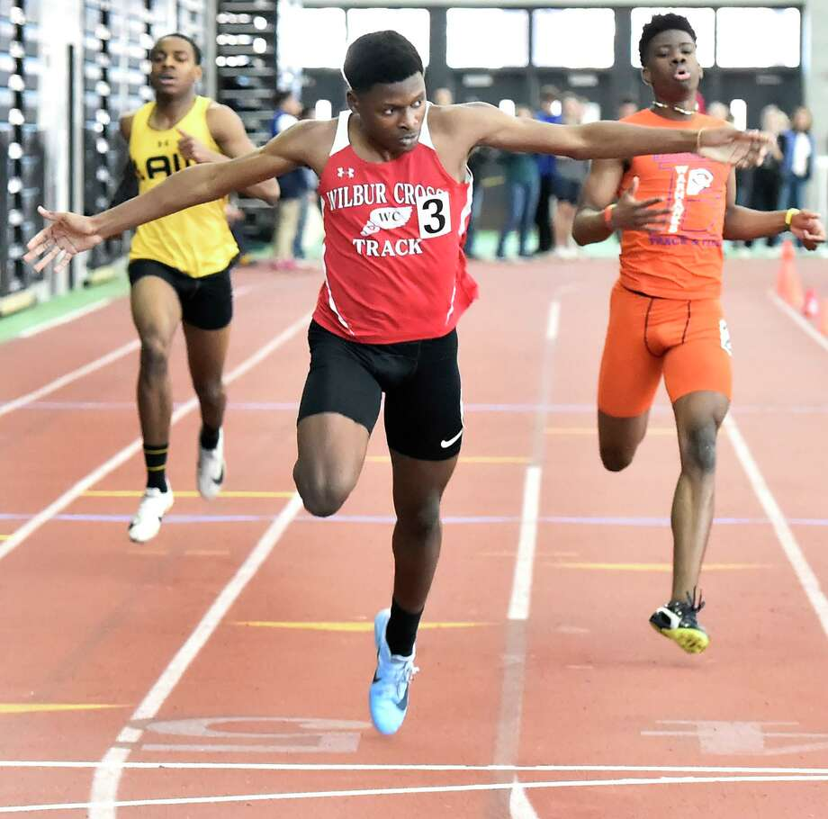 New Haven Connecticut - February 22, 2020: Caleb Owen of Wilbur Cross H.S. wins the boys 300-meter dash finals, center, crossing the finish line against third-place finisher Kymali Hay of Bloomfield H.S., right, and fourth-place finisher Rayshon Jacobs of Jonathan Law H.S, left. Jason Lorent of Shelton H.S. finished in second place. during the CIAC State Open Indoor Track Championship Saturday at the Floyd Little Athletic Center in New Haven. Photo: Peter Hvizdak / Hearst Connecticut Media / New Haven Register