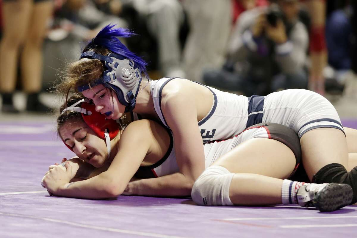 College Parks Olivia Degeorgio, top, and Tascosa's Mia Diaz, bottom, in their Class 6A-95lbs championship match of the state high school wrestling championships Saturday, Feb. 22, 2020 at the Berry Center in Cypress, TX.