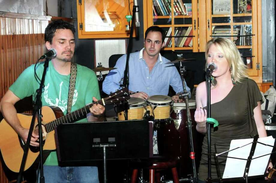 Purcussionist, Quinton Gelderman, performs with vocalist, Kristen Laine right, and guitarist George Hanlon, at O'Connor's Public House, in Brookfield, Conn, on Thursday, August 12, 2010. Photo: Jay Weir / The News-Times Freelance