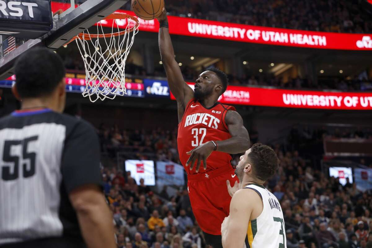 Houston Rockets' Jeff Green (32) attempts a layup as Utah Jazz's Georges Niang looks on in the first half during an NBA basketball game Saturday, Feb. 22, 2020, in Salt Lake City. (AP Photo/Kim Raff)
