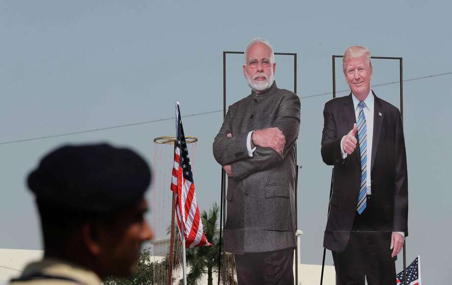 A policeman stands near huge cut out images of U.S. President Donald Trump and Indian Prime Minister Narendra Modi displayed ahead of Trump's visit in Ahmedabad, India, Sunday, Feb. 23, 2020. The sun-baked northwestern Indian city was jostling with activity Sunday as workers cleaned roads, planted flowers and hoisted hundreds of billboards featuring President Donald Trump, a day ahead of his maiden two-day visit to India after Prime Minister Narendra Modi promised him a boisterous public reception. Photo: Aijaz Rahi, AP / Copyright 2020 The Associated Press. All rights reserved.