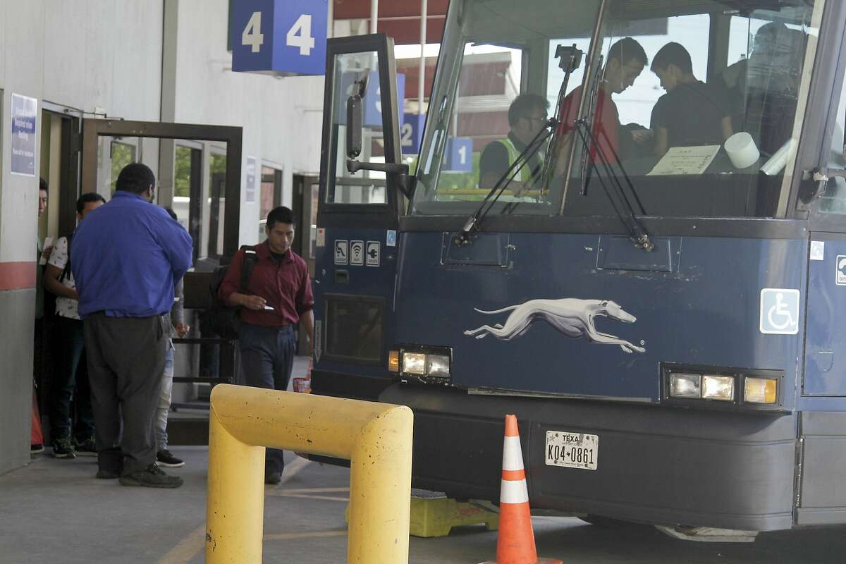 FILE - In this April 2, 2019, file photo, an asylum seeker from Guatemala boards a Greyhound bus in El Paso, Texas. Greyhound, the nation's largest bus company, says it will stop allowing Border Patrol agents without a warrant to board its buses to conduct routine immigration checks. The company announced the change Friday, Feb. 21, 2020, one week after The Associated Press reported on a leaked Border Patrol memo confirming that agents can't board private buses without the consent of the bus company. (AP Photo/Cedar Attanasio, File)