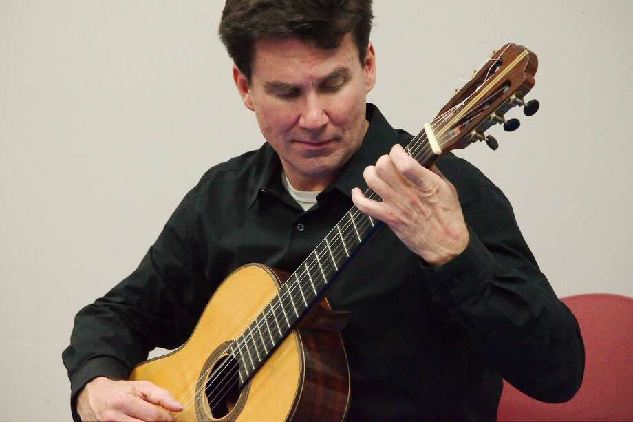 Acclaimed classical guitarist Peter Fletcher performed during a free concert at the Harris County Freeman Library Saturday, Feb. 22. Photo: Kirk Sides/Staff Photographer