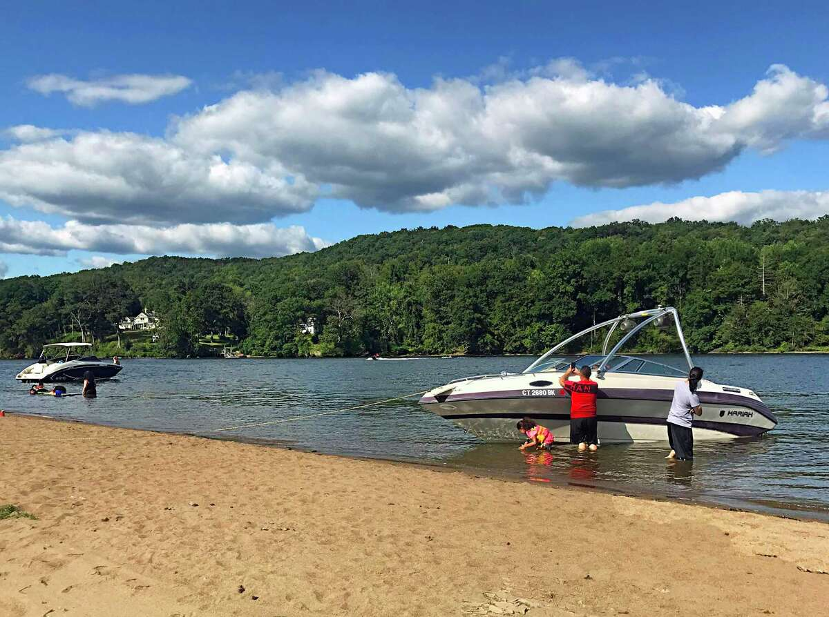 Boaters drop anchor along the large sandbar that forms at Haddam Meadows during low tide on the Connecticut River. Many enjoy socializing, picnicking and swimming during the warmer months.