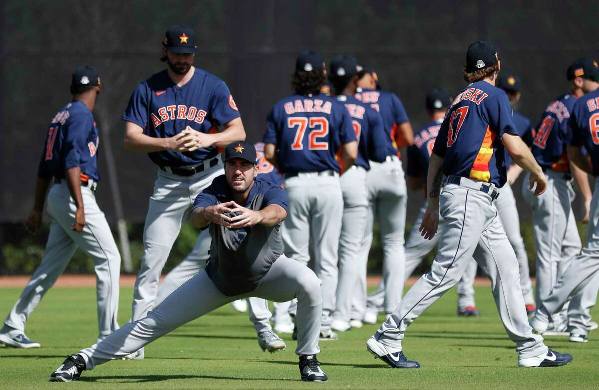 Houston Astros pitcher Justin Verlander (35) stretches during spring training workouts at the Fitteam Ballpark of The Palm Beaches, in West Palm Beach, Sunday, Feb. 23, 2020.