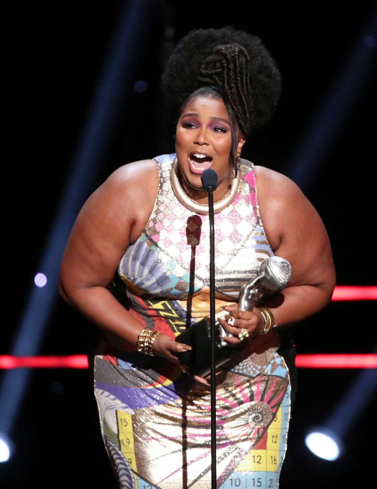 PASADENA, CALIFORNIA - FEBRUARY 22: Lizzo accepts Entertainer of the Year onstage during the 51st NAACP Image Awards, Presented by BET, at Pasadena Civic Auditorium on February 22, 2020 in Pasadena, California. (Photo by Rich Fury/Getty Images)