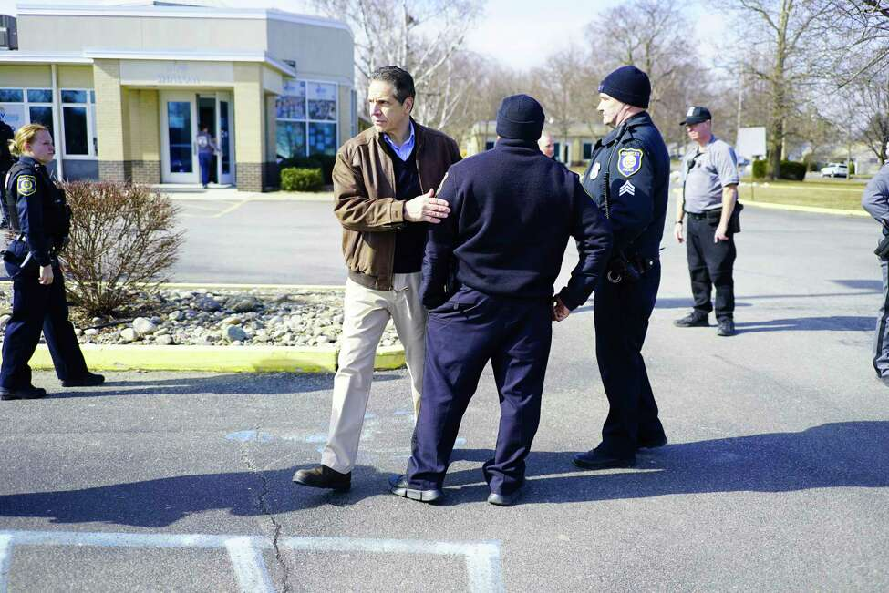 New York Governor Andrew Cuomo, left, thanks Albany Police officers outside the Albany Jewish Community Center on Sunday, Feb. 23, 2020, in Albany, N.Y. The JCC was closed after receiving a vague emailed threat. (Paul Buckowski/Times Union)