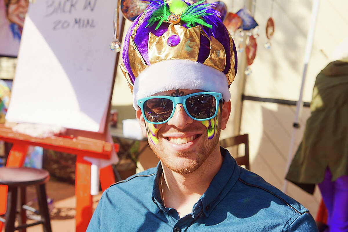 San Antonians celebrate at the Arneson River Theatre to partake in the Mardi Gras Festival and River Parade on Saturday, February 22, 2020.