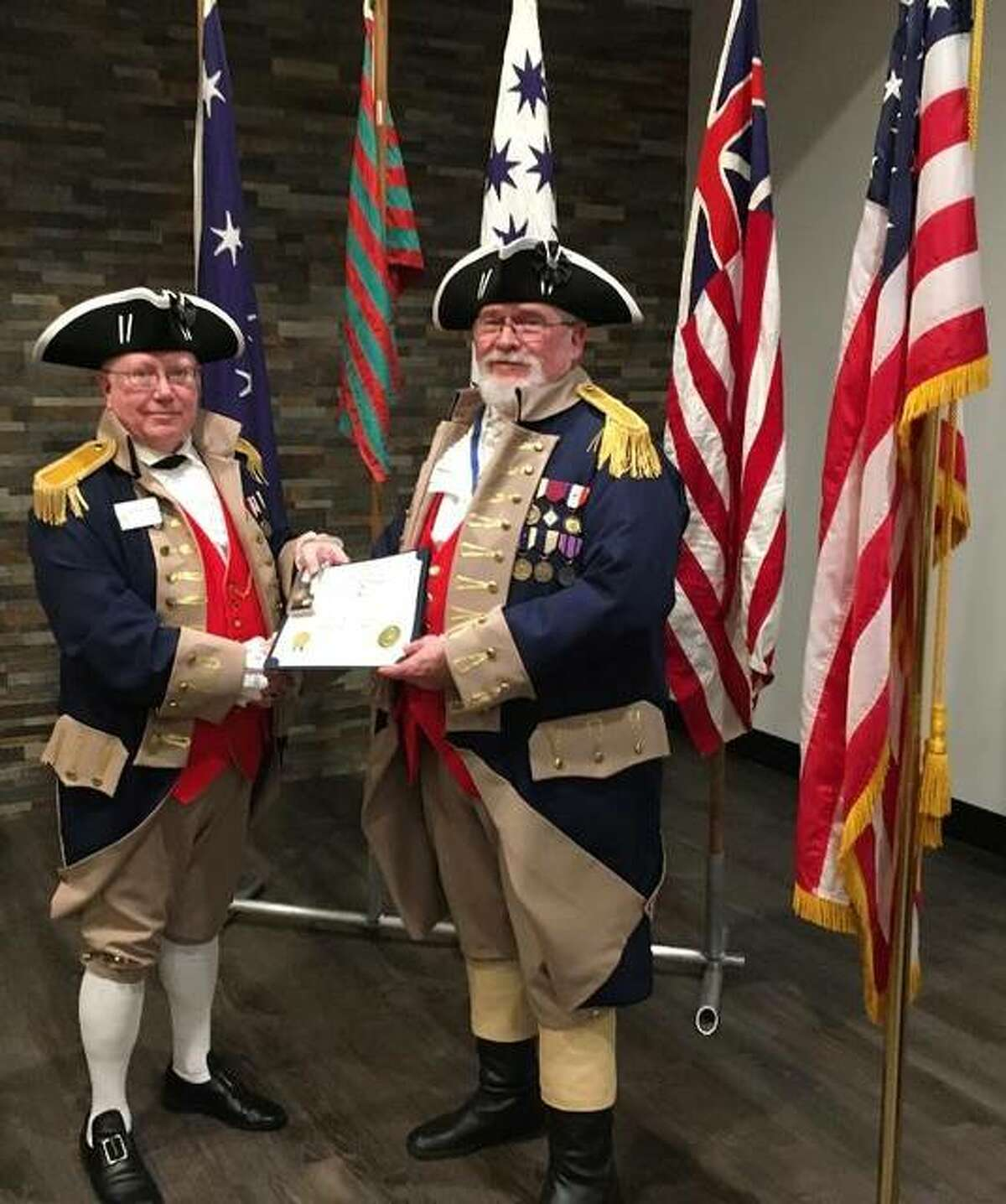 Chapter president Robert Ridenour presents the Sherman Medal for leadership to Richard Ruedin, vice president of the Gen. George Rogers Clark Chapter of the Sons of the American Revolution, on Feb. 20 in East Alton.