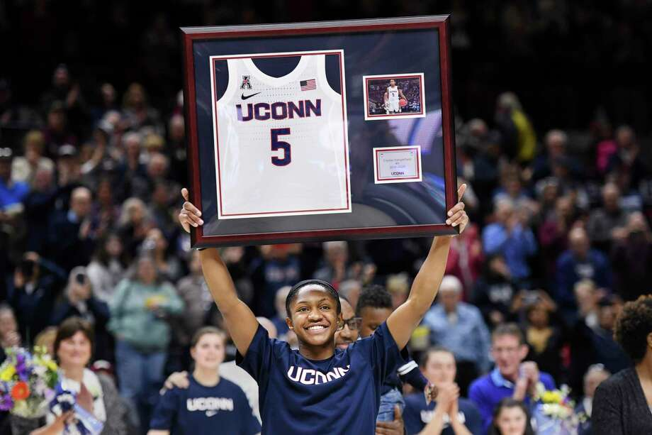 UConn's Crystal Dangerfield (5) holds up her framed jersey during senior day ceremonies held before an NCAA college basketball game against Central Florida Saturday, Feb. 22, 2020, in Storrs Photo: Stephen Dunn / Associated Press / Copyright 2020 The Associated Press. All rights reserved