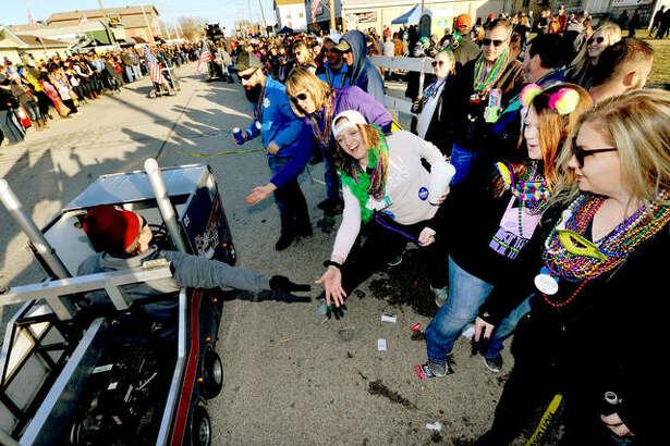 Parade goers enjoy the Wordi Gras parade in Worden Saturday.
