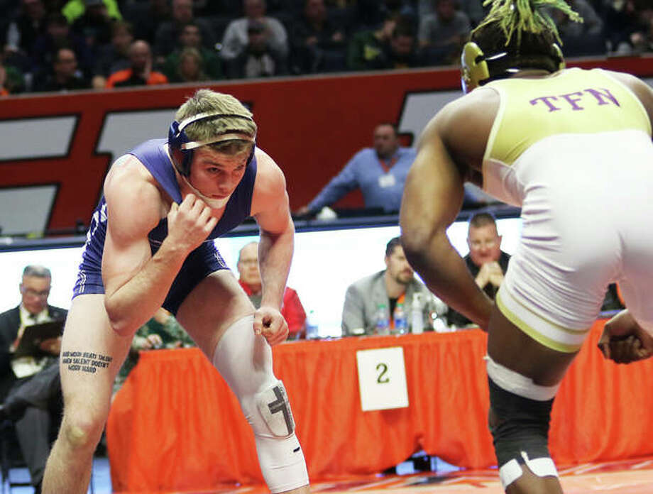 Jersey's Zeke Waltz (left) looks for an opening against Thornton Fractional North's Bilal Bailey during their 160-pound championship match in the Class 2A wrestling state tournament at State Farm Center in Champaign. Waltz lost a 6-3 decision to finish his season at 43-1. Photo: Greg Shashack / The Telegraph