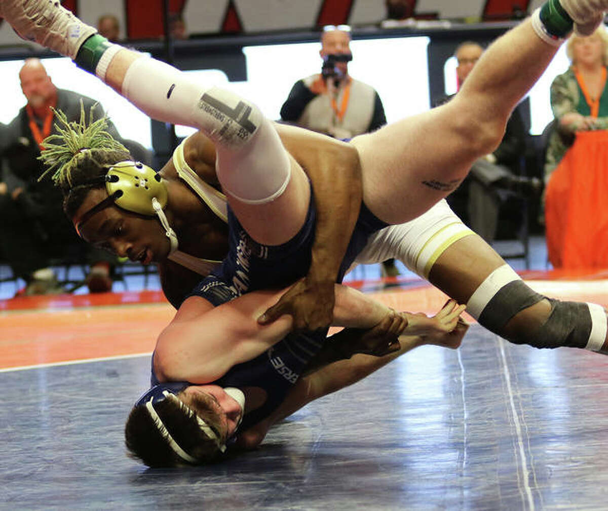 Jersey's Zeke Waltz (bottom) avoids going to his back against Thornton Fractional North's Bilal Bailey during their 160-pound championship match in the Class 2A wrestling state tournament at State Farm Center in Champaign.