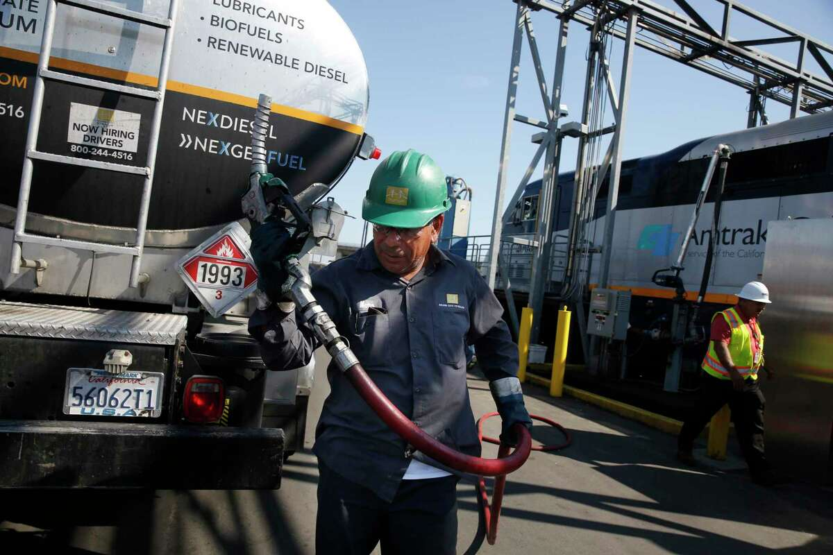 A truck driver after filling an Amtrak locomotive with renewable diesel in Oakland, Calif.