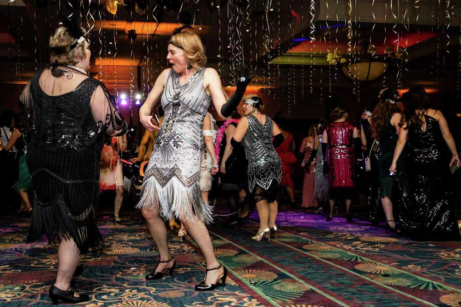 Jenny Seidel dances to the music during the annual Mom Prom Saturday at Great Hall Banquet & Convention Center in Midland. For more photos, go to www.ourmidland.com. (Cody Scanlan/for the Daily News)