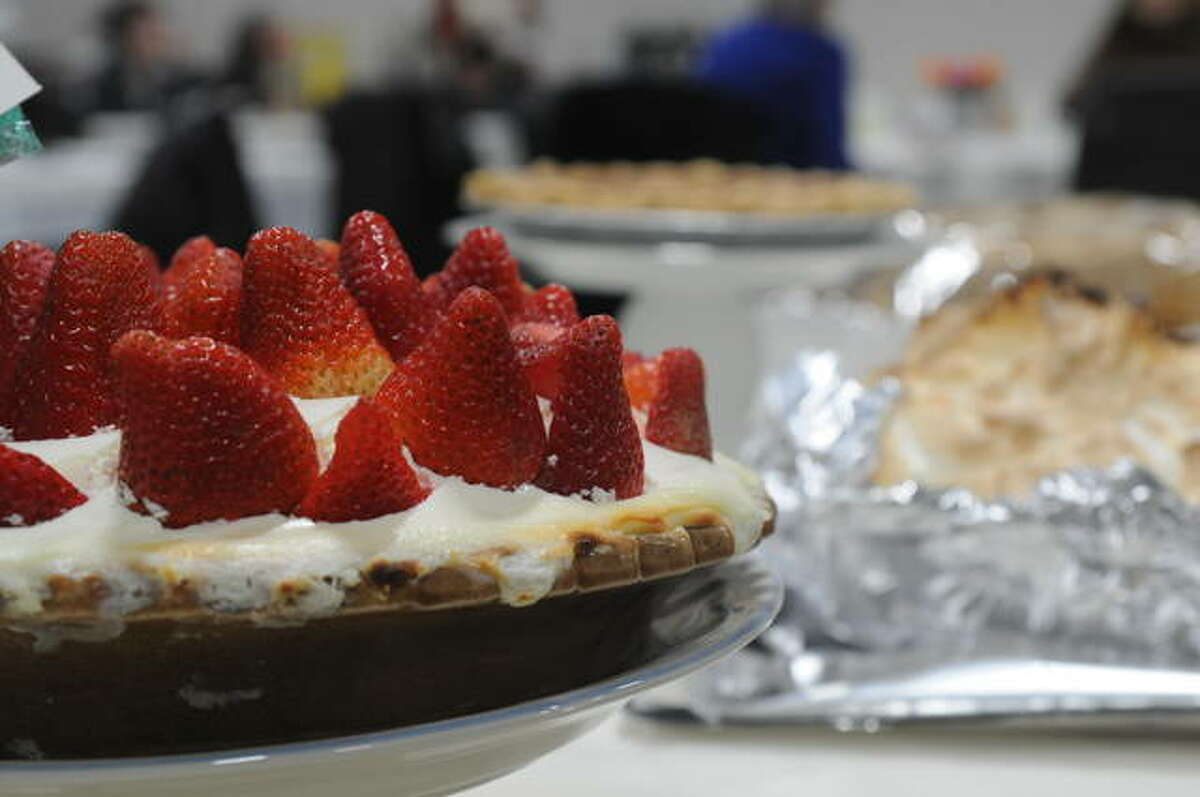 Some of the 80 entries in Sunday's pie auction await bidders at the Main Street United Methodist Church in Alton. The event provides funding for the Encounter Youth Choir.
