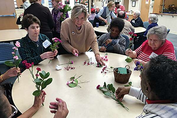 Recently The Riverside Garden Club came to the River House Adult Day Center to engage in some garden therapy with the clients. The club's design chair Eileen August leads a group of River House Clients in the workshop which helped beautify the facility.