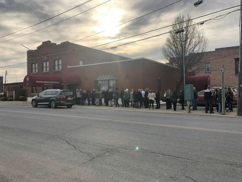 Mourners line the block outside the Parker Bros. Memorial building in Watervliet, N.Y. on Sunday, Feb. 23, 2020 to remember the life of Brandon M. Sylvester, a Green Island teenager who was killed Feb. 8 while trying to cross Route 787 in Green Island.