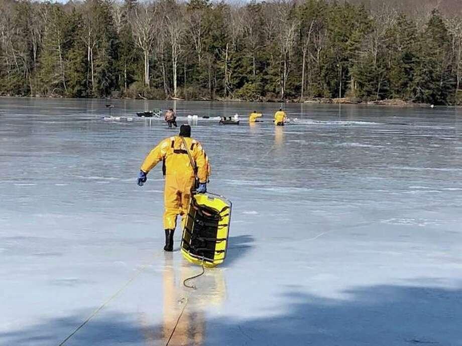 Torrington firefighters rescuing fishermen who had fallen through the ice on Burr Mountain Pond this morning. Photo: / Torrington Fire Department