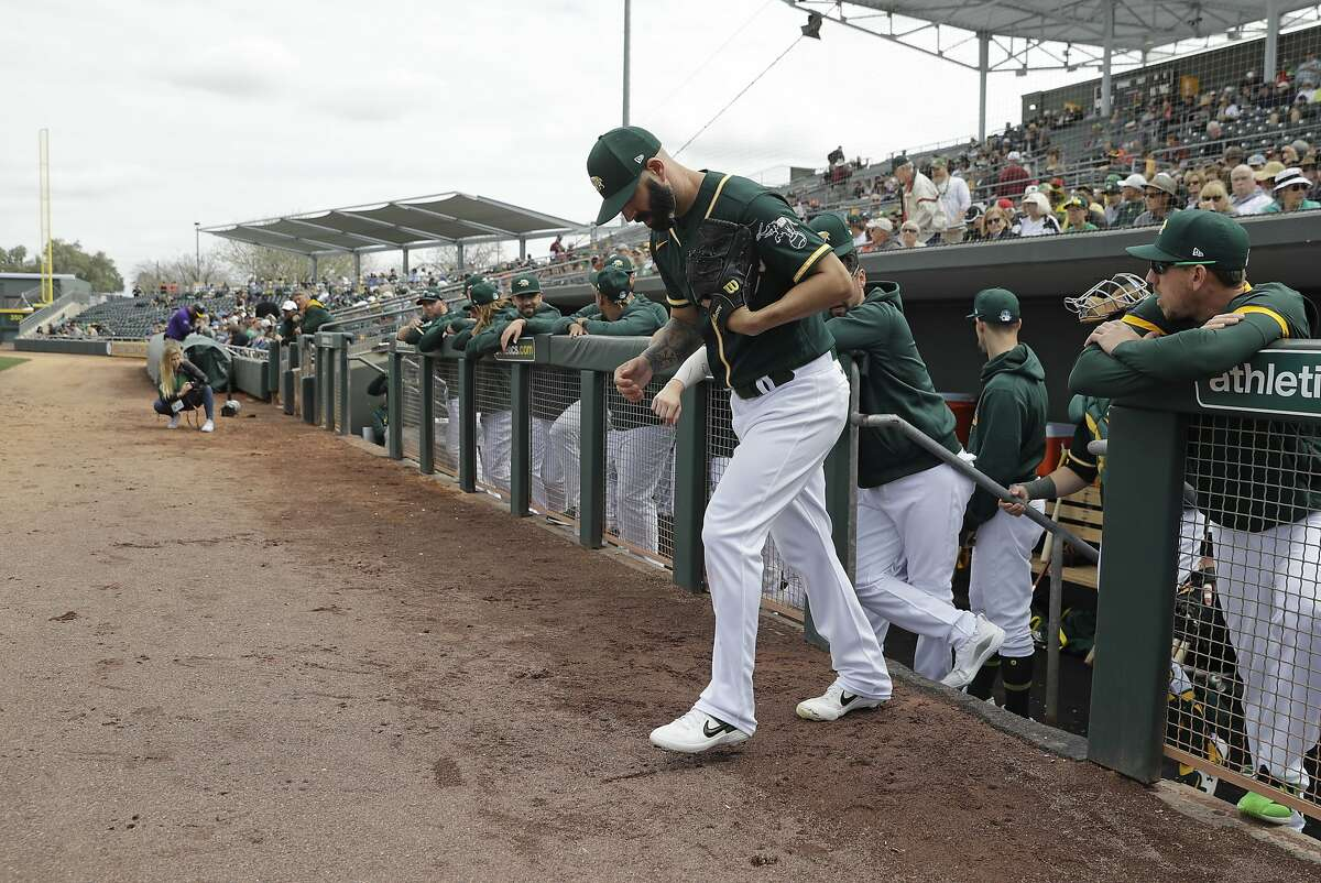 Oakland Athletics' Mike Fiers walks to the pitching mound during a spring training baseball game against the San Francisco Giants, Sunday, Feb. 23, 2020, in Mesa, Ariz. (AP Photo/Darron Cummings)