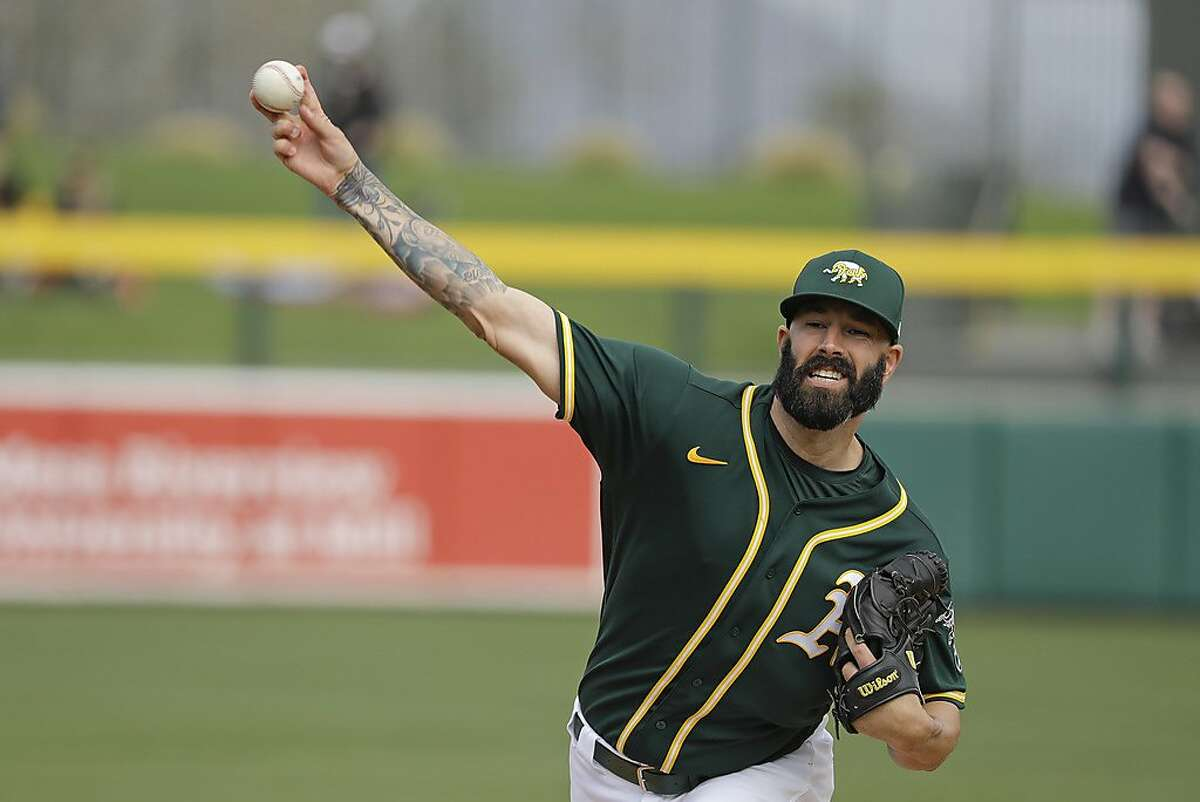 Oakland Athletics' Mike Fiers throws during the first inning of a spring training baseball game against the San Francisco Giants, Sunday, Feb. 23, 2020, in Mesa, Ariz. (AP Photo/Darron Cummings)