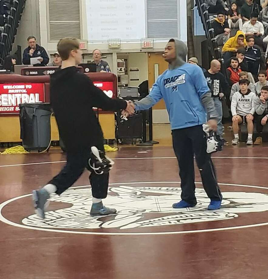 Middletown's Khalil Shabazz, right, shakes hands with Pomperaug's Michael Carpenter after winning their Class L championship match at 126 pounds. Photo: Contributed Photo