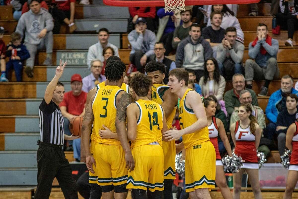 Siena basketball team huddle on the court during a game against Fairfield on Sunday, February 23, 2020. (Peter McLean / Fairfield Athletics)