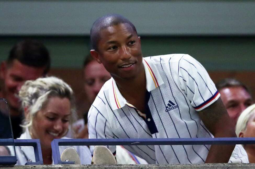 NEW YORK, NY - AUGUST 28: Pharrell Williams attends the first round Women's Singles match between Simona Halep of Romania and Maria Sharapova of Russia on Day One of the 2017 US Open at the USTA Billie Jean King National Tennis Center on August 28, 2017 in the Flushing neighborhood of the Queens borough of New York City. (Photo by Clive Brunskill/Getty Images) ORG XMIT: 700042999