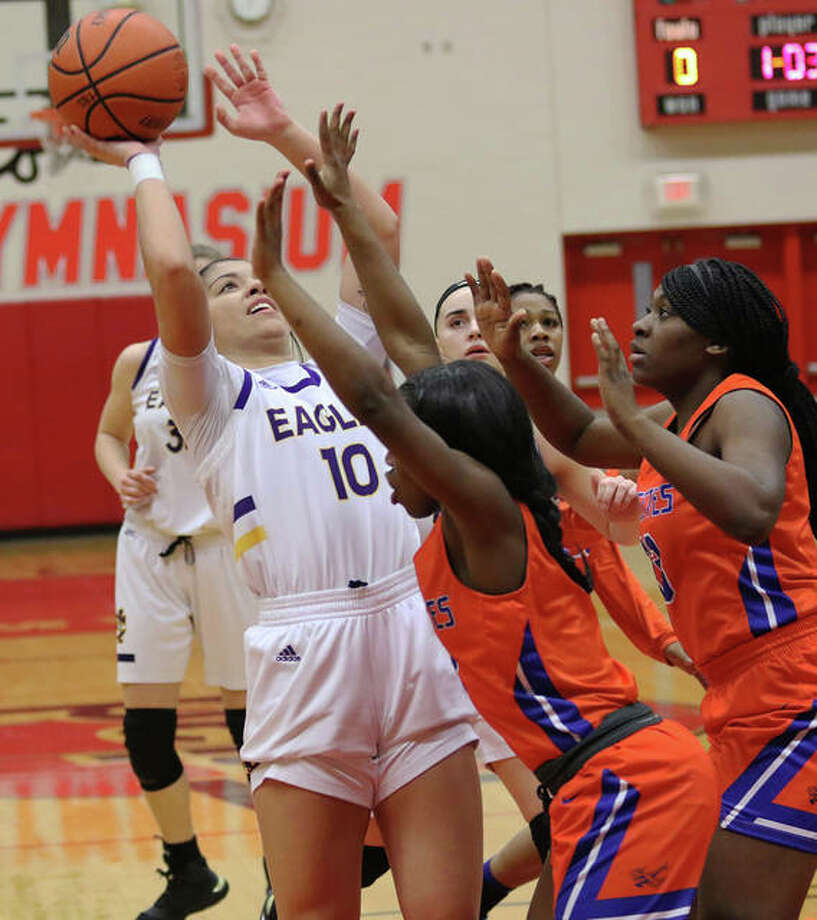 CM's Kourtland Tyus (10) shoots over East St. Louis defenders in the lane during Thursday's Triad Class 3A Regional championship game in Troy. The Eagles play Monday in a sectional semifinal at Effingham. Photo: Greg Shashack / The Telegraph