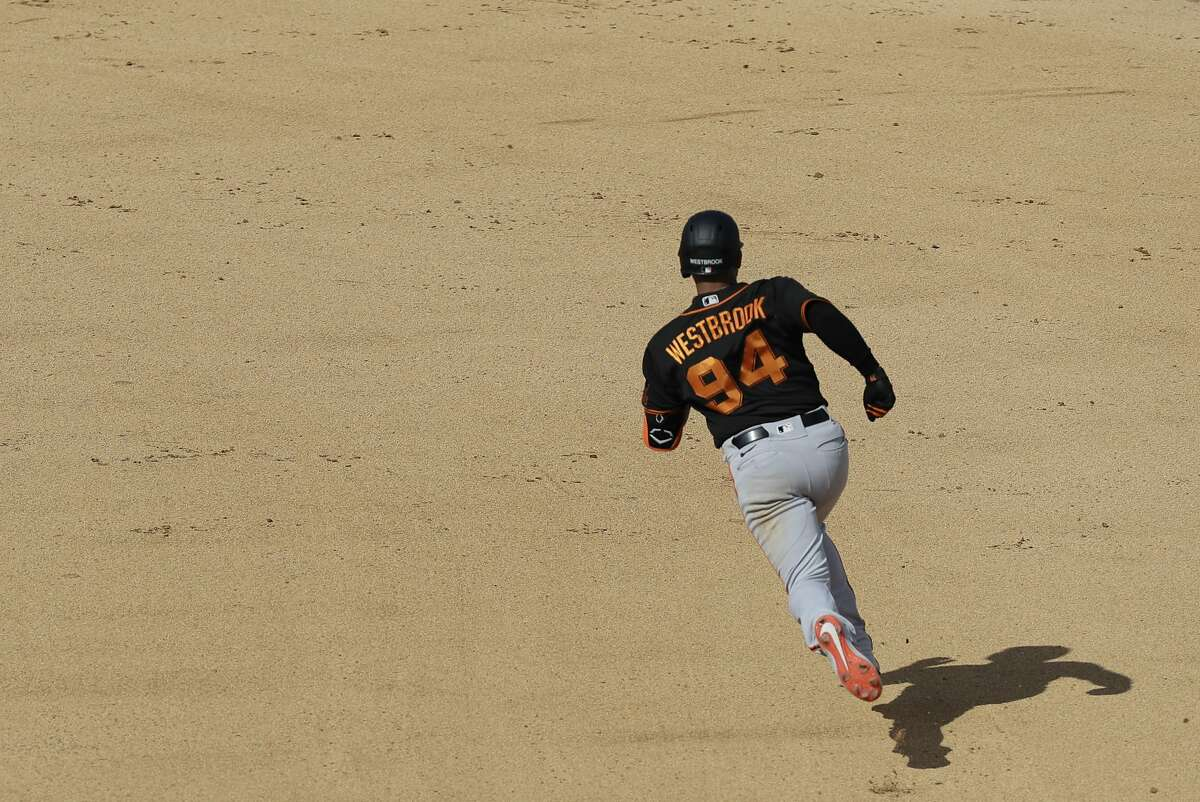 San Francisco Giants' Jamie Westbrook hits a double during the fifth inning of a spring training baseball game against the Oakland Athletics, Sunday, Feb. 23, 2020, in Mesa, Ariz. (AP Photo/Darron Cummings)