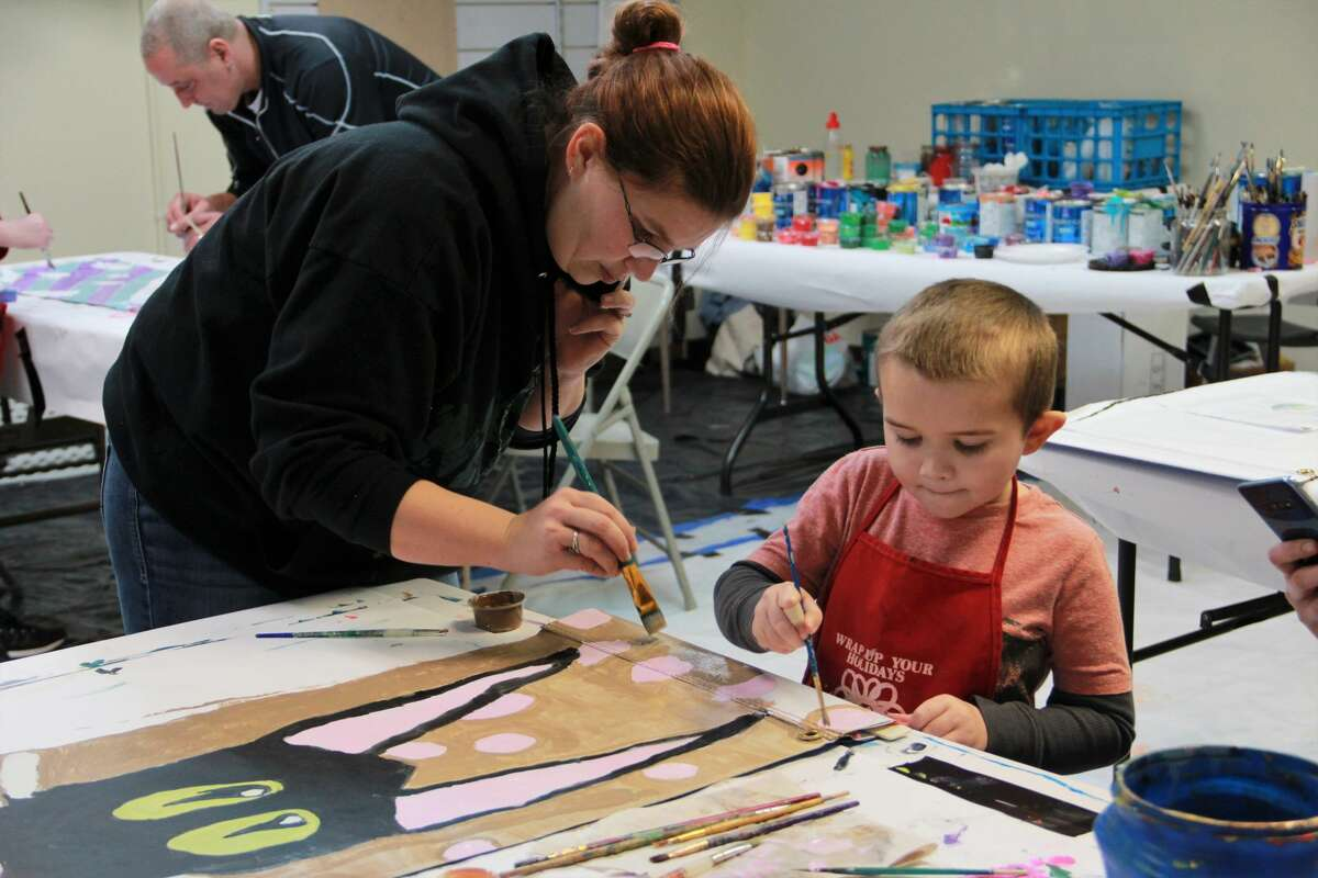 Area families filled Artworks as they practiced their painting skills Saturday during a Festival of Banners workshop. The program was open to residents of all ages and gave families the opportunity to paint banners which will be displayed on light posts around Big Rapids. One side of the banner shows the business sponsors, while the other side displays artwork done by kids, teens and adults. (Pioneer file photo)