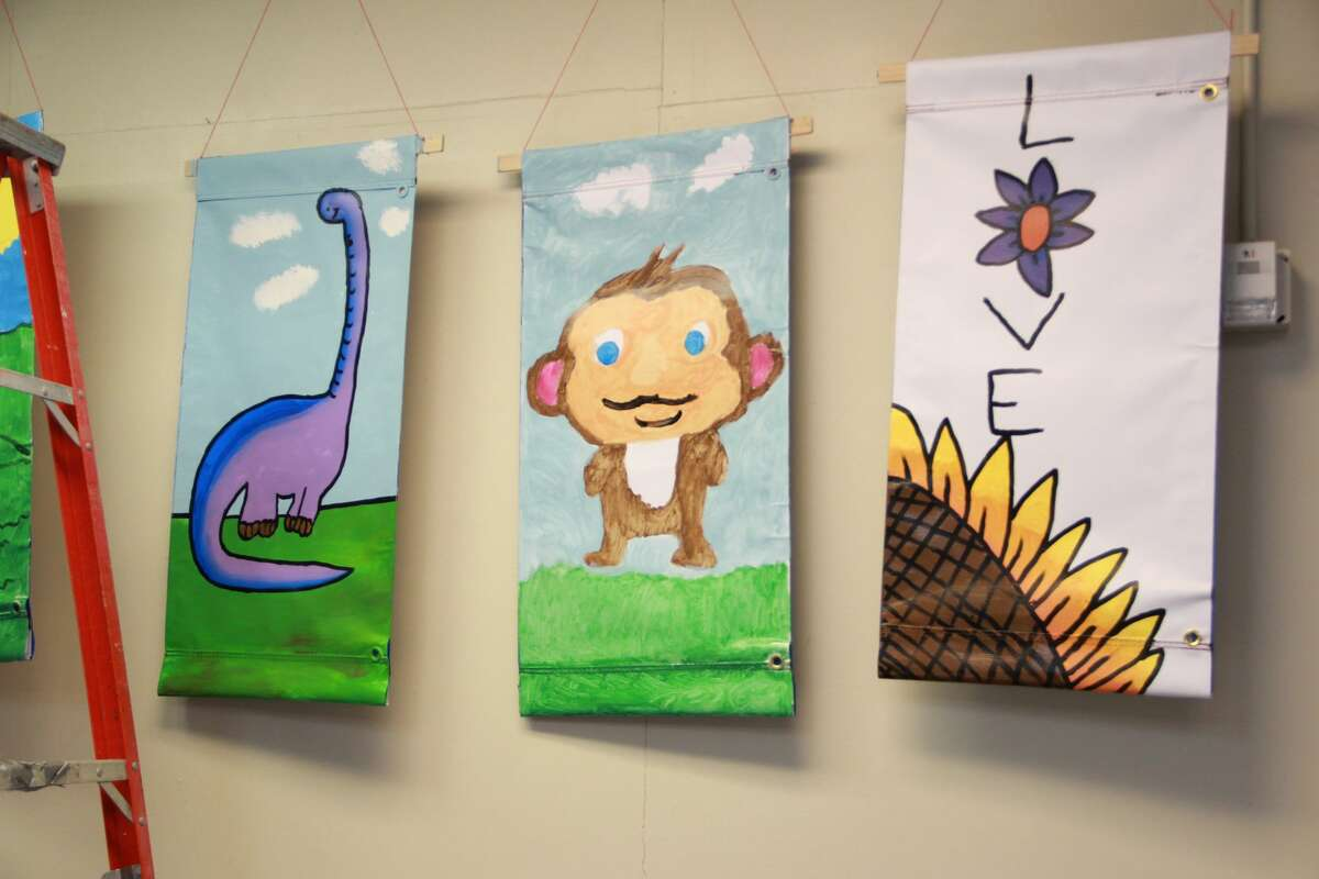 Area families filled Artworks as they practiced their painting skills Saturday during a Festival of Banners workshop. The program was open to residents of all ages and gave families the opportunity to paint banners which will be displayed on light posts around Big Rapids. One side of the banner shows the business sponsors, while the other side displays artwork done by kids, teens and adults.