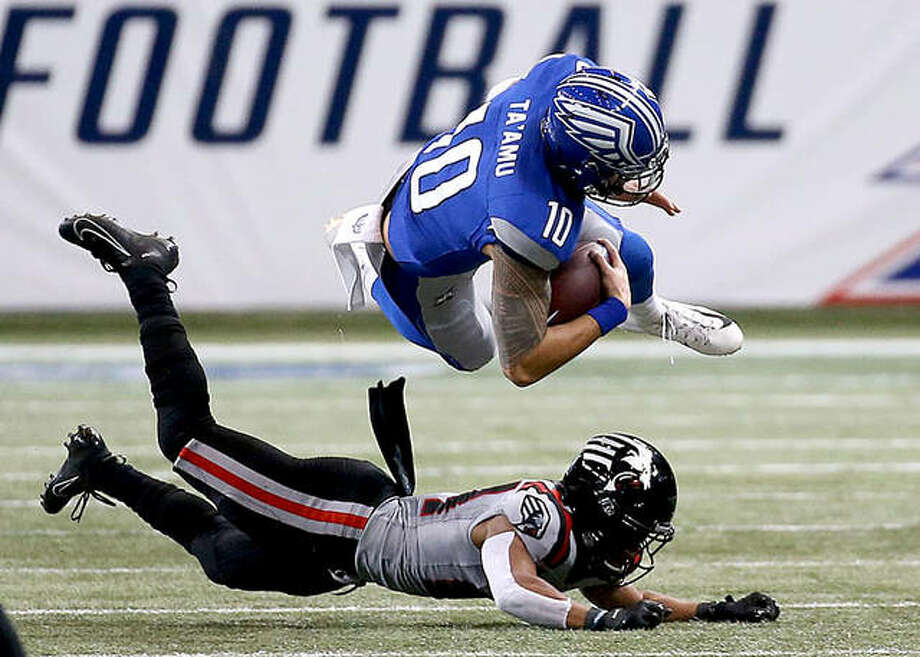 BattleHawks quarterback Jordan Ta'Amu (10) goes airborne after being hit by a New York Guardians defender Sunday at the dome at America's Center. Photo: Scott Kane, XFL | For The Telegraph