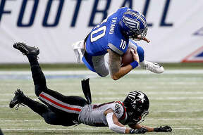 BattleHawks quarterback Jordan Ta'Amu (10) goes airborne after being hit by a New York Guardians defender Sunday at the dome at America's Center.