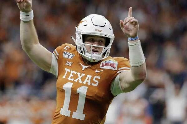 Texas quarterback Sam Ehlinger celebrates a touchdown during the first half of the Valero Alamo Bowl against Utah on Dec. 31, 2019.