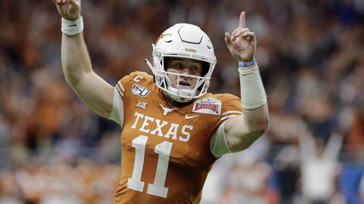 Texas quarterback Sam Ehlinger reacts to a touchodnw during the first half of the Alamo Bowl against Utah at the Alamodome on Dec. 31, 2019.
