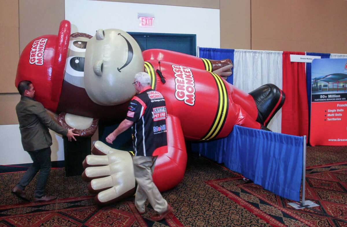 An inflatable for Grease Monkey Oil Changes & More goes up at the Great American Franchise Expo in Stafford on February 23, 2020.