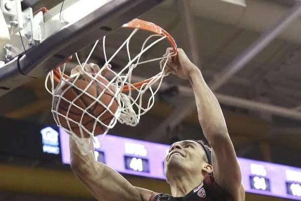 Stanford's Oscar da Silva dunks against Washington late in the second half of an NCAA college basketball game Thursday, Feb. 20, 2020, in Seattle. Stanford won 72-64. (AP Photo/Elaine Thompson)