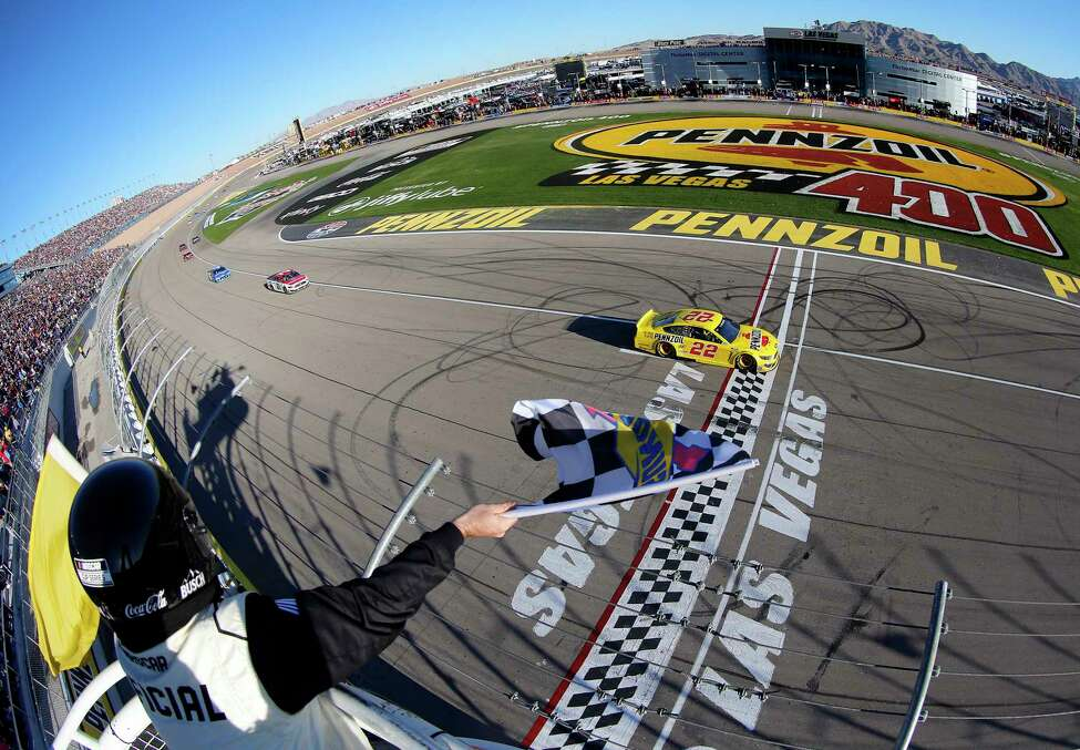 LAS VEGAS, NEVADA - FEBRUARY 23: Joey Logano, driver of the #22 Pennzoil Ford, takes the checkered/yellow flag to win the NASCAR Cup Series Pennzoil 400 at Las Vegas Motor Speedway on February 23, 2020 in Las Vegas, Nevada. (Photo by Jonathan Ferrey/Getty Images)