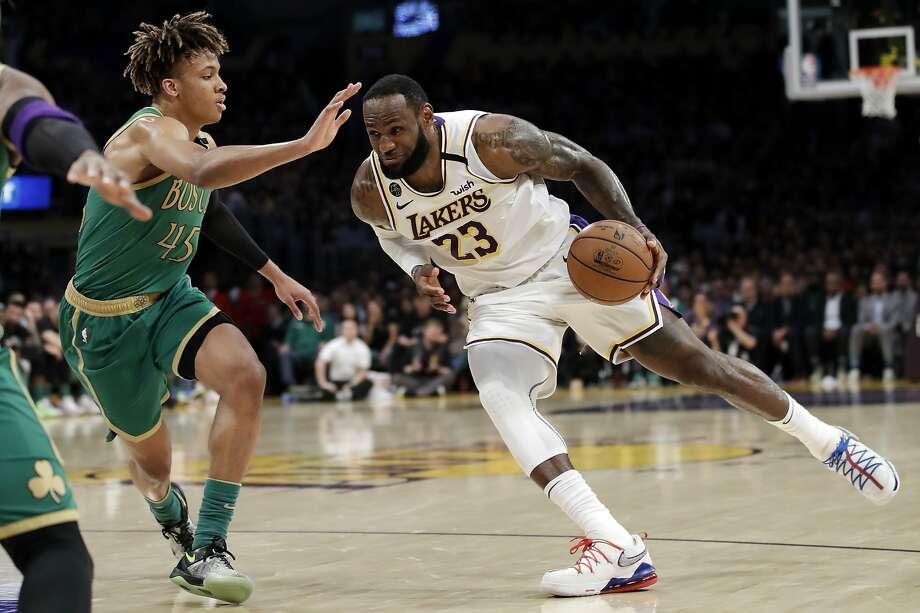 The Lakers' LeBron James, who scored 29 points, dribbles past the Celtics' Romeo Langford. Photo: Marcio Jose Sanchez / Associated Press