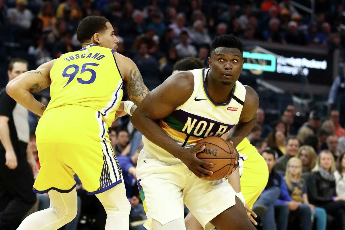 SAN FRANCISCO, CALIFORNIA - FEBRUARY 23: Zion Williamson #1 of the New Orleans Pelicans drives on Juan Toscano-Anderson #95 of the Golden State Warriors at Chase Center on February 23, 2020 in San Francisco, California. NOTE TO USER: User expressly acknowledges and agrees that, by downloading and or using this photograph, User is consenting to the terms and conditions of the Getty Images License Agreement. (Photo by Ezra Shaw/Getty Images)
