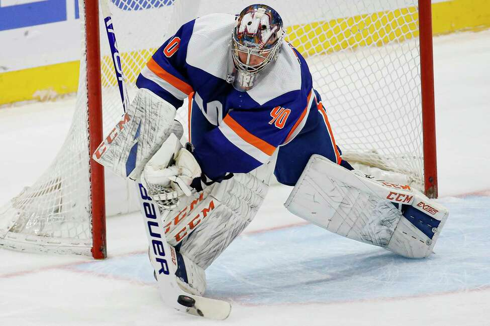 New York Islanders goaltender Semyon Varlamov (40) makes a save during the third period of an NHL hockey game against the San Jose Sharks, Sunday, Feb. 23, 2020, in Uniondale, N.Y. (AP Photo/John Minchillo)