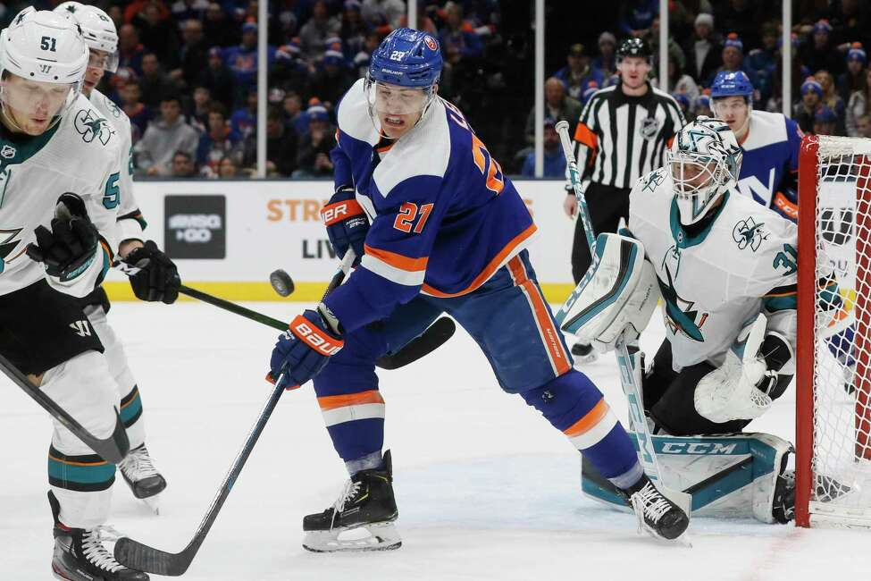 New York Islanders left wing Anders Lee (27) loses control of the puck on a play at the net against San Jose Sharks goaltender Martin Jones (31) during the second period of an NHL hockey game, Sunday, Feb. 23, 2020, in Uniondale, NY. (AP Photo/John Minchillo)