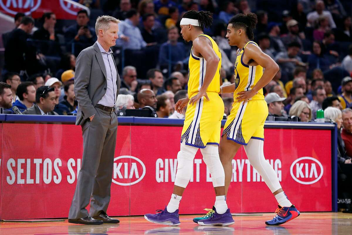 Golden State Warriors' head coach Steve Kerr with Damion Lee and Jordan Poole during 4th quarter of New Orleans Pelicans' 115-101 win in NBA game at Chase Center in San Francisco, Calif., on Sunday, February 23, 2020.