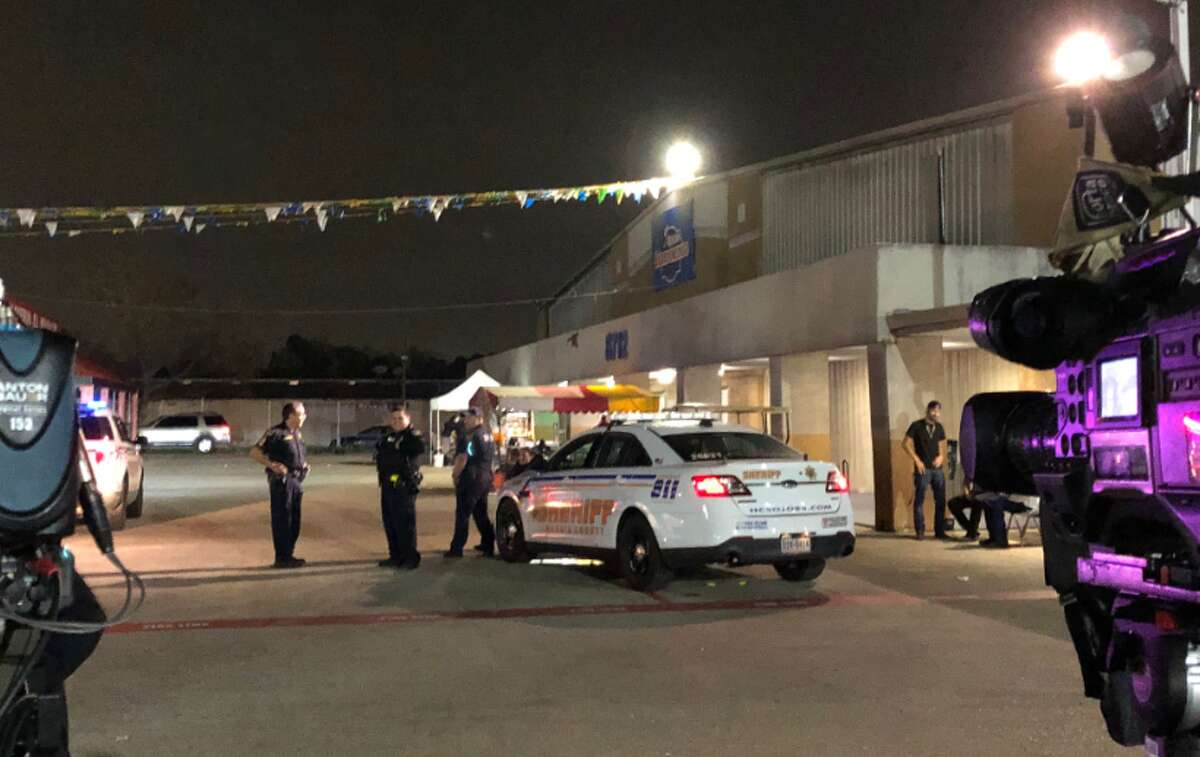 Seven people were hospitalized and one man was detained Sunday after a shooting at a Houston-area flea market.