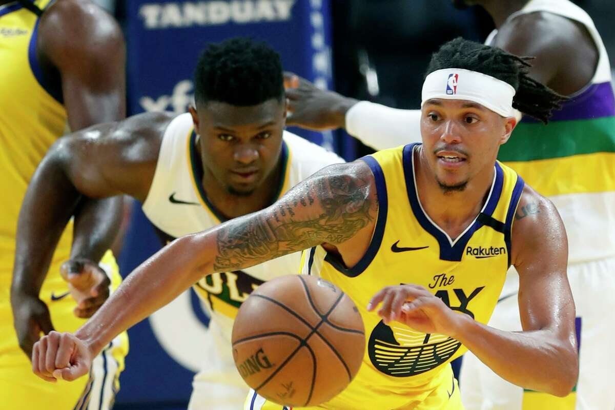 Golden State Warriors' Damion Lee leaves New Orleans Pelicans' Zion Williamson behind as he heads upcourt in 2nd quarter during NBA game at Chase Center in San Francisco, Calif., on Sunday, February 23, 2020.