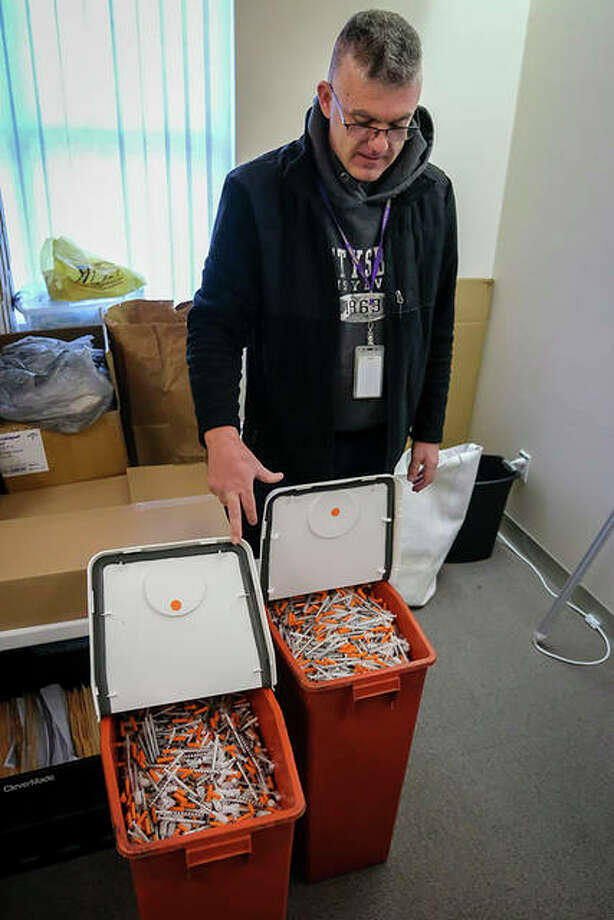 Scott Fletcher of The Community Action Place shows two months' worth of used syringes the organization has collected prior to their sanitary disposal in Murphysboro. Photo: Byron Hetzler | Southern Illinoisan (AP)