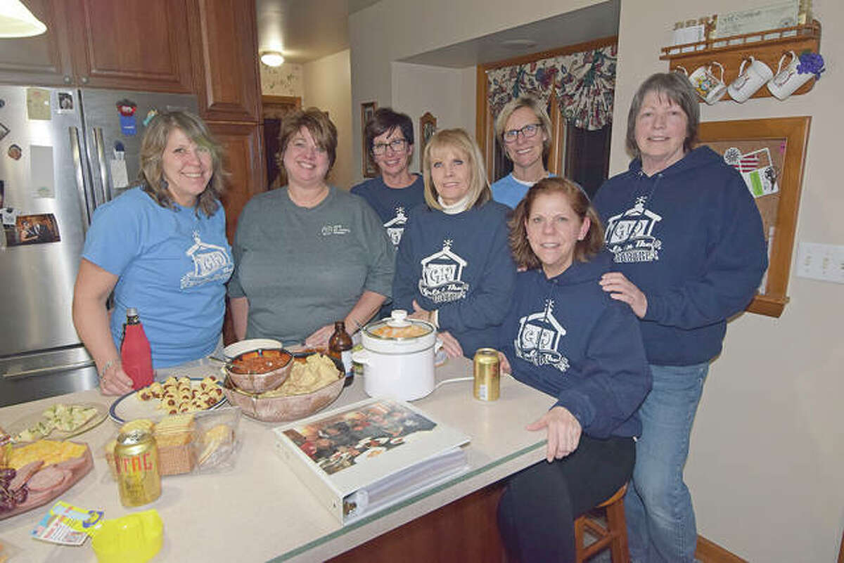 Girls in the Garage members enjoy food and drinks after completing a project at a member's house. They are Judy Tighe (from left), Tammy Middleton, Lisa Kluge, Daphne Spradlin, Lori Hartz, Barb Whalen and Anne Jackson.