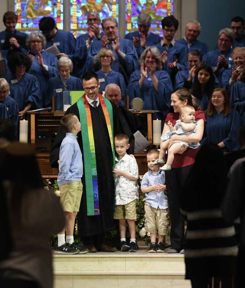 The Rev. Patrick Collins was all smiles as he gathered with his wife, Kate, and children, Emmett, Micah, Jonah, and Norah, while being formally installed as Senior Minister at First Congregational Church of Greenwich. But now coronavirus has forced the church to close until further notice. Sunday services will be live streamed on YouTube and WGCH. Photo: Tyler Sizemore / Hearst Connecticut Media / Greenwich Time